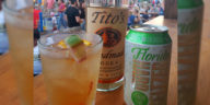 A mixed drink, a bottle of Tito's Vodka, and a can of 3 Daughters Brewing's Florida Hard Seltzer