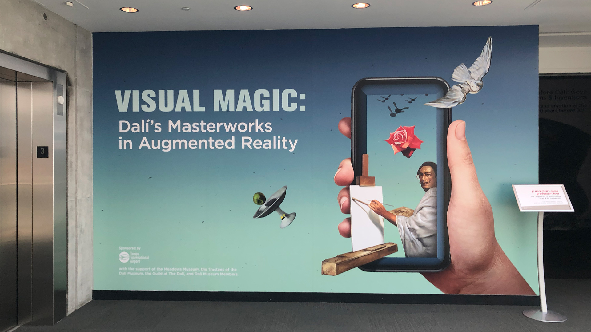 "The sign for ""Visual Magic: Dali's Masterpieces in Augmented Reality"""