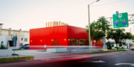 The new MedMen building, a red cube style as viewed across the street.