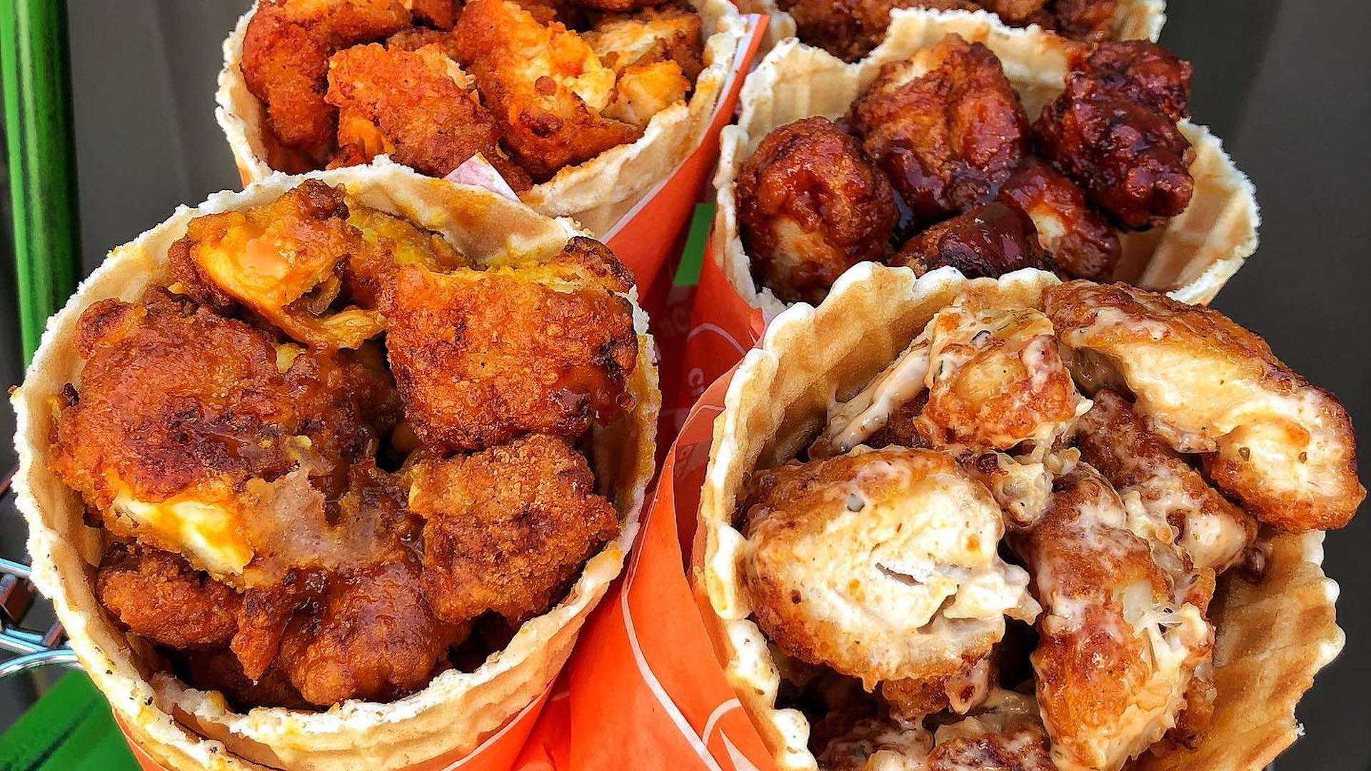 Photo of fried chicken inside of large waffle cones