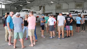 A group of volunteers gather at Albert Whitted Airport in St. Petersburg