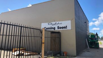 "Photo of brewery with ""Coming Soon"" banner on the outside"