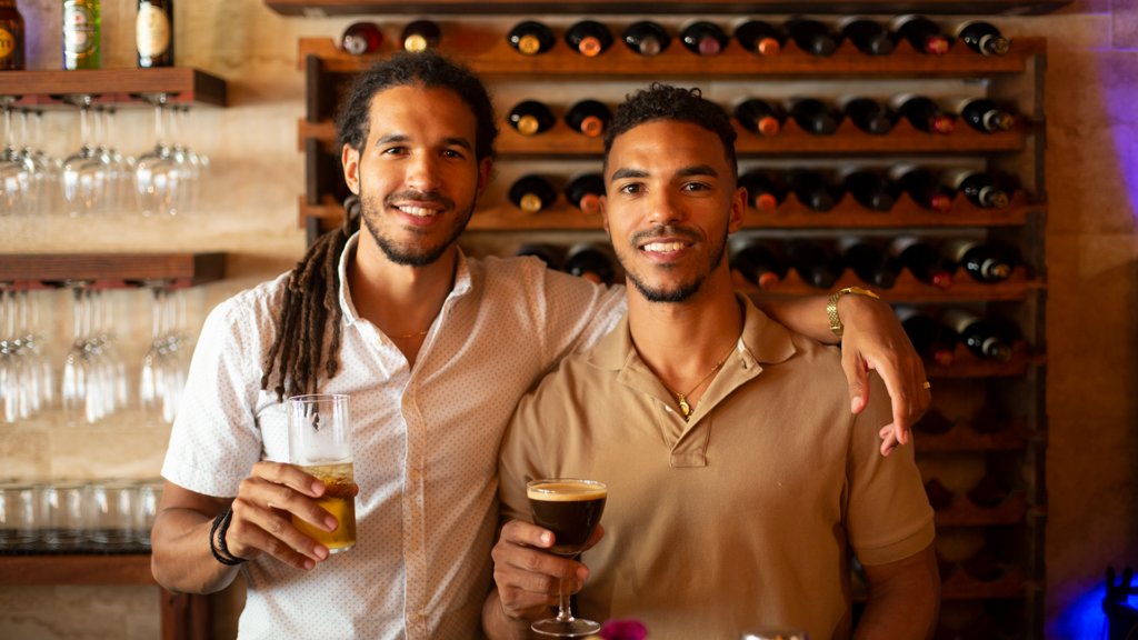 Photo of two brothers standing behind a bar