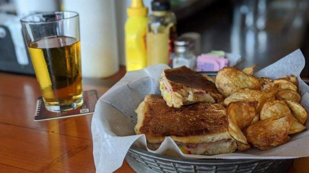 Photo of a Cuban sandwich and potato chips