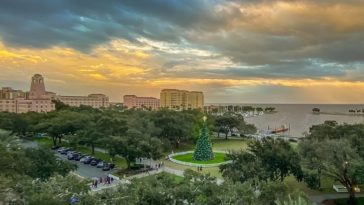 View of downtown St. Petersburg, Florida, with a giant Christmas tree, and a historic pink hotel.