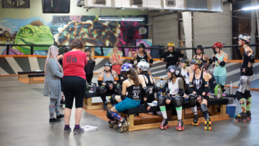 Team meeting inside a roller derby track