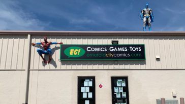 Exterior of a comic book shop with spider-man and batman