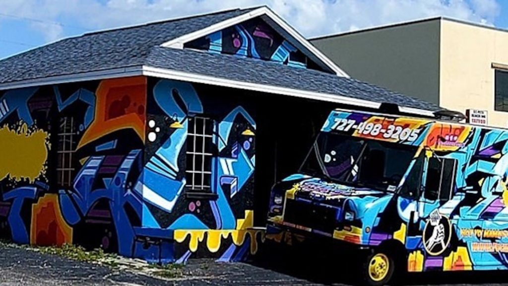 Mural covered exterior of a new grilled cheese restaurant