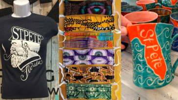 Assortment of locally made goods: st. Pete t-shirt, st. Pete mug, and cloth masks