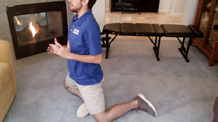 Chiropractor demonstrated an at home work out to assist with mobility