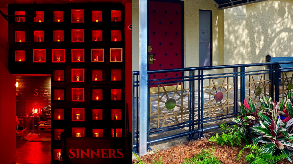 Interior and exterior of a new speakeasy with red lighting, a wall of candles and exterior green landscaping