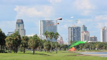 Photo of kites flying over a waterfront park