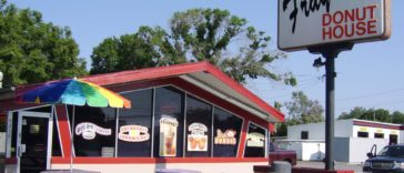 Exterior of a drive thru donut shop