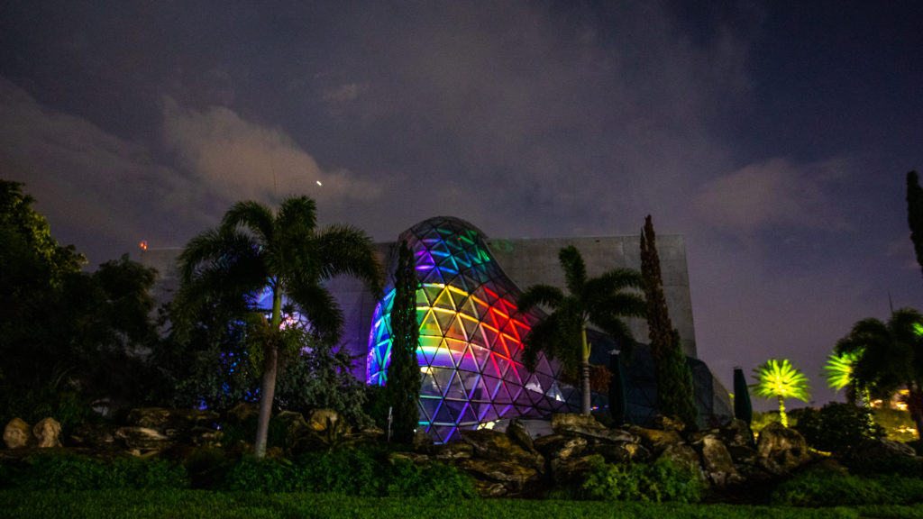 Exterior of the Dali Museum with a large glass atrium with rainbow lights