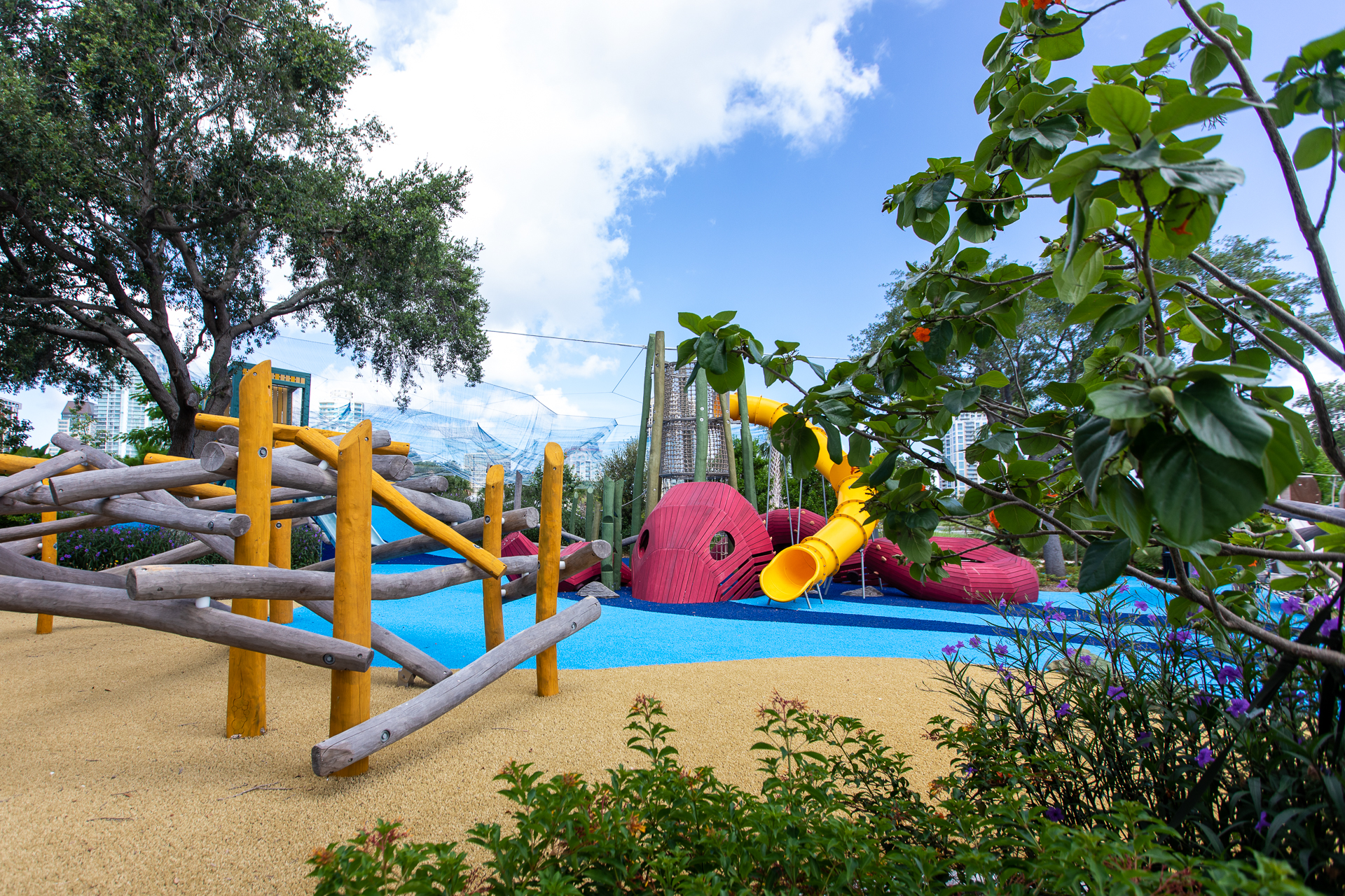 Photo of a waterfront playground with an octopus slide