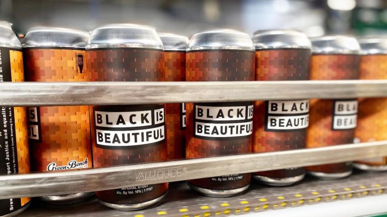 "Photo of beer cans with a label that says ""black is beautiful"""