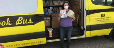 Photo of a yellow bus filled with books