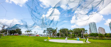 Photo of a large art installation iin a waterfront park