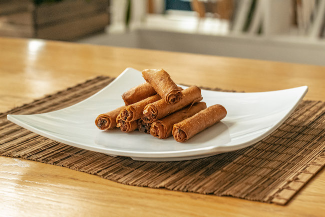 A plate of rolled pork lumpia