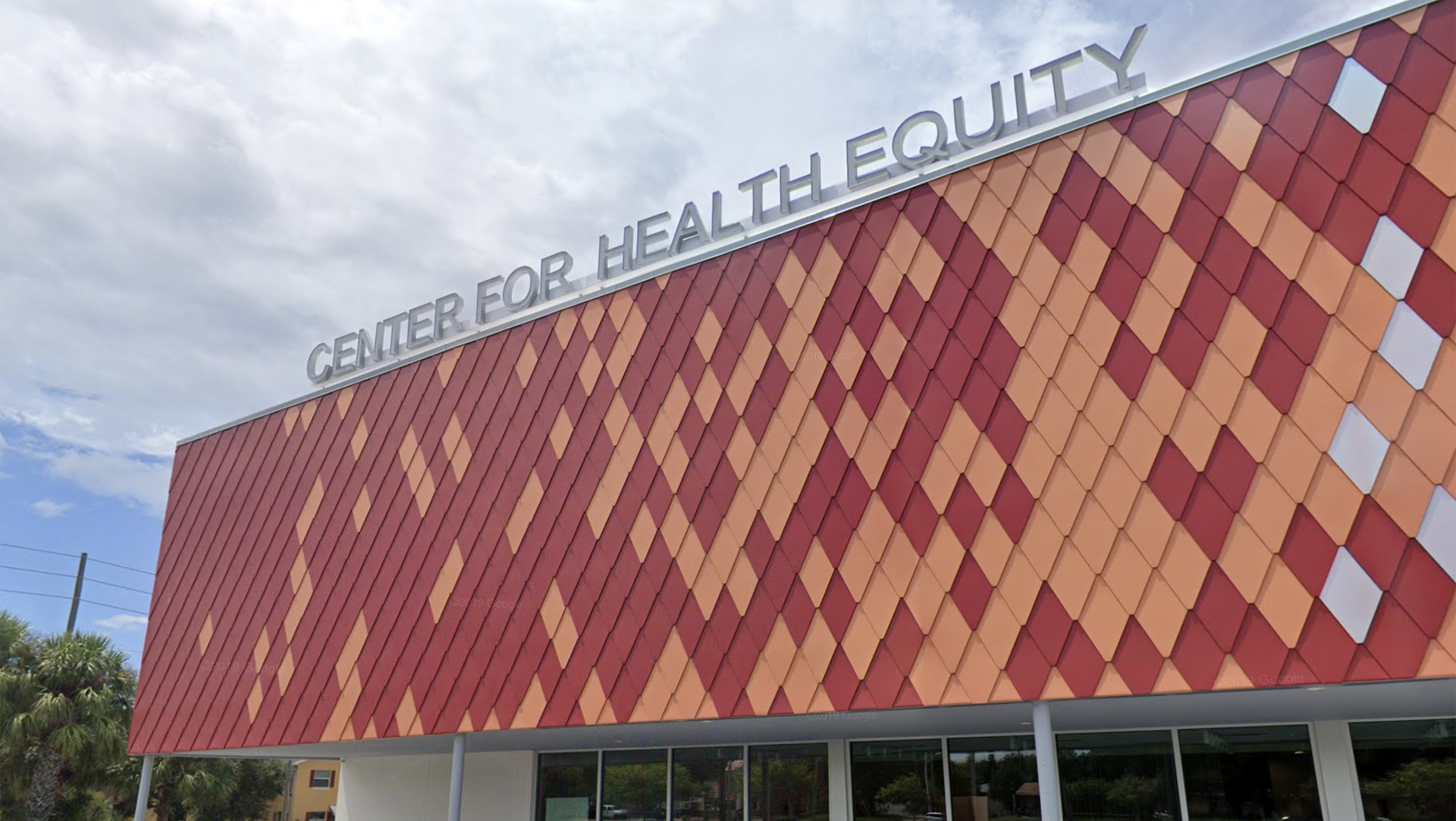 "Exterior of large building with word ""Center for Health Equity"" on top"
