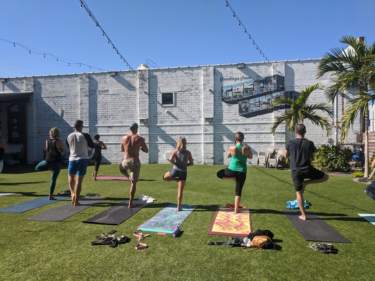 Image of yogis on mats at Green Bench outdoor