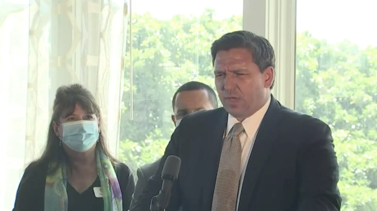 Image of Ron DeSantis speaking on a podium