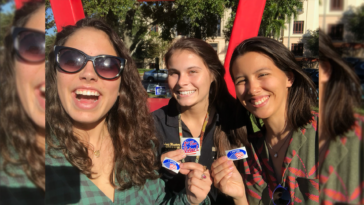Three individuals holding I Voted stickers outside their polling place