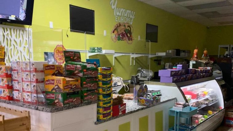 Inside a Eurpoean grocery store, with various cookies and chocolate bars on the counter