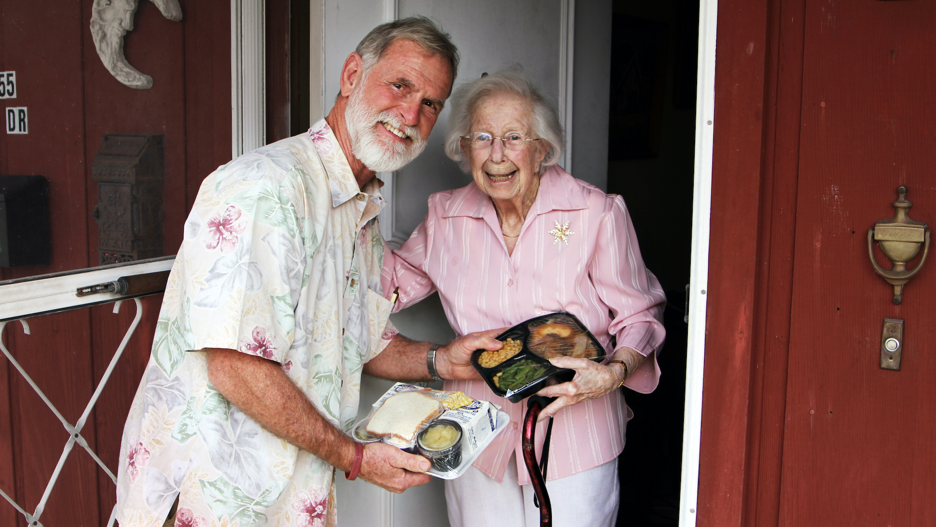 Meals on Wheels delivery to a senior resident