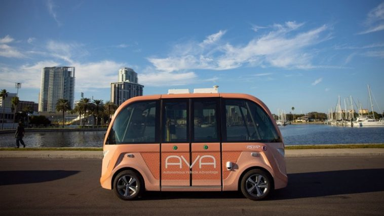 Image of a light orange self-driving car on the waterfront