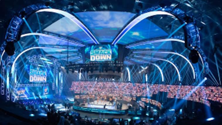 Inside a wrestling arena with blue lights