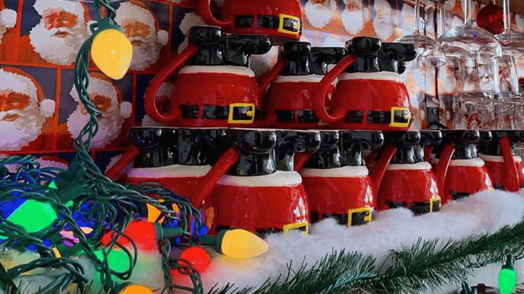 Arrangement of upside down Santa mugs