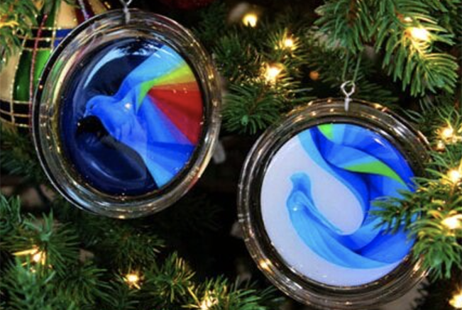 Photo of ornaments with murals of birds and mermaids