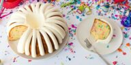 Photo of a bundt cake with icing and rain