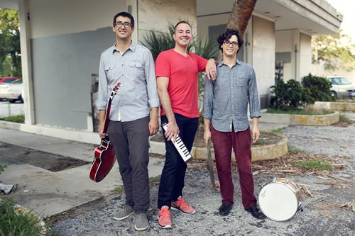 Image of La Lucha band standing outdoors