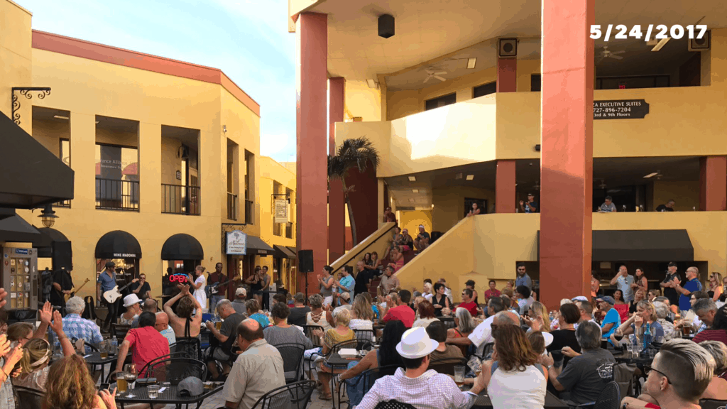 Outside on a patio where live music is being performed