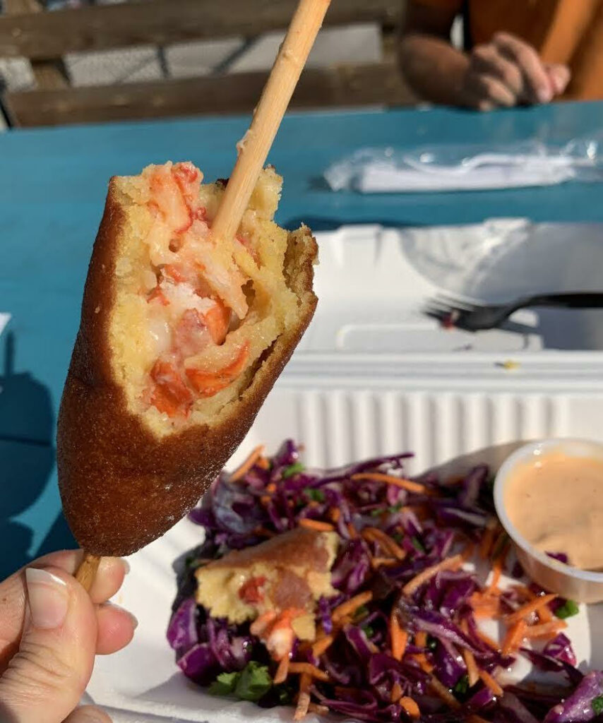"""An innovative, carnival-style treat, Funnel Vision's """"lobster corn dog"""" is a fun option for local palettes."""