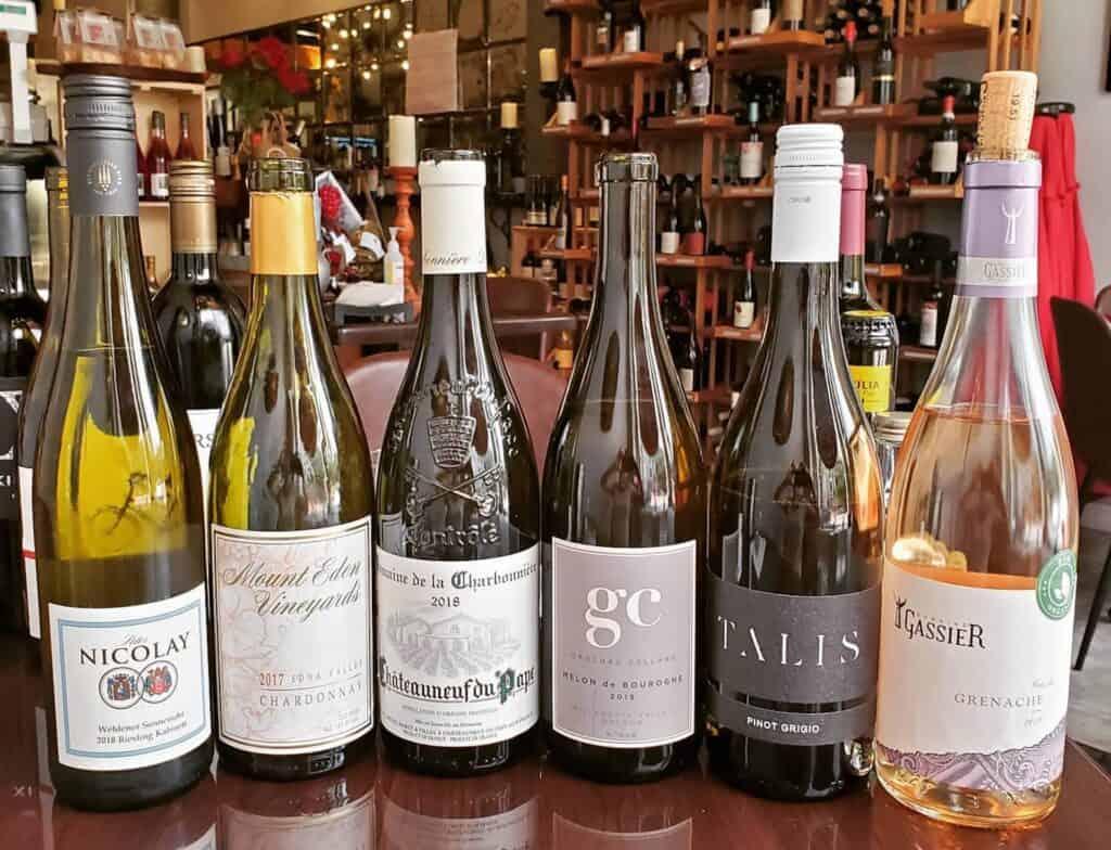 assortment of wine bottles inside a wine bar