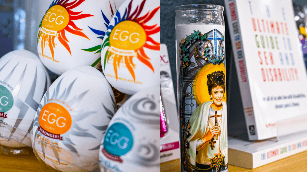 assortment of egg-shaped containers with. rainbow logos, a tall candle with a book propped up against it