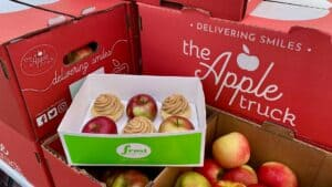 photo of apples in a basket with cupcakes